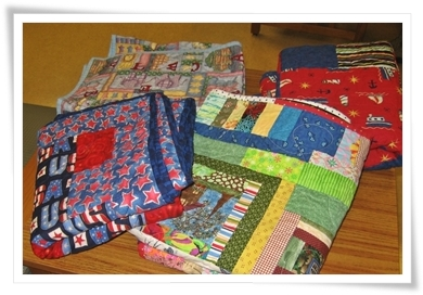 We started out with 8 quilts.  Two more, the boat one and the patriotic one had found a home by the time we left.