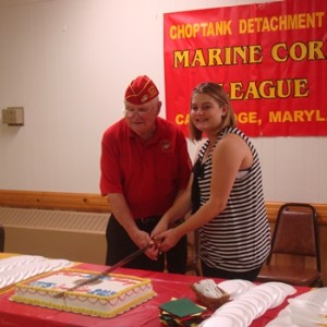 Oldest and youngest Marine cutting the cake