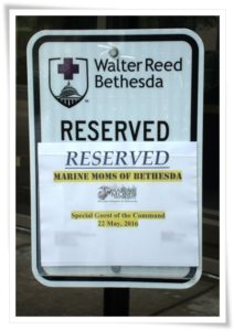 Reserved parking sign in front of the hospital.