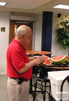 Cutting up the watermelon.