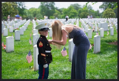 Memorial Day Weekend 2017 - Section 60 Brittany Jacobs fixes her son, Christian's, medals on his Marine uniform on Memorial Day at Arlington National Cemetery, Arlington, Va., May 29, 2017. Brittany and Christian come to Section 60 every year to honor Christian's father. (U.S. Army photo by Elizabeth Fraser / Arlington National Cemetery / released)