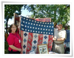 Jane and Guy holding Stars and Bars Forever