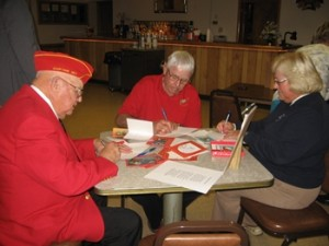 Writing Holiday Cheer notes for Marine Moms_Bethesda's December 5th luncheon at Mercy Hall.